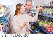 Купить «Couple choosing candies in store», фото № 29666697, снято 11 апреля 2018 г. (c) Яков Филимонов / Фотобанк Лори
