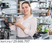 Купить «Female customer choosing new pan for kitchen in the kitchenware shop», фото № 29666797, снято 2 мая 2018 г. (c) Яков Филимонов / Фотобанк Лори