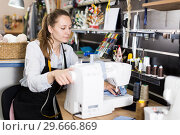 Female tailor working with sewing machine at workshop. Стоковое фото, фотограф Яков Филимонов / Фотобанк Лори