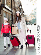 Купить «tourists girl and woman walking with baggage», фото № 29667029, снято 19 ноября 2017 г. (c) Яков Филимонов / Фотобанк Лори