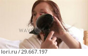 Купить «Woman Drying Hair», видеоролик № 29667197, снято 16 сентября 2019 г. (c) Wavebreak Media / Фотобанк Лори