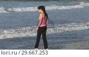 Купить «Woman Enjoying Beach Life», видеоролик № 29667253, снято 24 января 2019 г. (c) Wavebreak Media / Фотобанк Лори