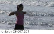 Купить «Woman Stretching on Beach», видеоролик № 29667261, снято 24 января 2019 г. (c) Wavebreak Media / Фотобанк Лори