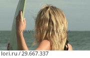 Купить «Woman with Surfboard», видеоролик № 29667337, снято 24 января 2019 г. (c) Wavebreak Media / Фотобанк Лори
