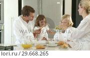 Купить «Happy Father and daughter having breakfast», видеоролик № 29668265, снято 2 апреля 2009 г. (c) Wavebreak Media / Фотобанк Лори