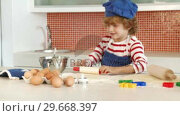 Son baking in the Kitchen. Стоковое видео, агентство Wavebreak Media / Фотобанк Лори