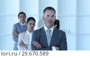Купить «Businessman leading his team with folded arms», видеоролик № 29670589, снято 1 октября 2009 г. (c) Wavebreak Media / Фотобанк Лори