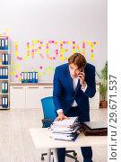 Купить «Young employee suffering from excessive work», фото № 29671537, снято 5 сентября 2018 г. (c) Elnur / Фотобанк Лори