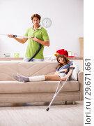 Купить «Husband helping leg injured wife in housework», фото № 29671661, снято 4 октября 2018 г. (c) Elnur / Фотобанк Лори
