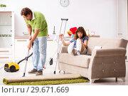 Купить «Husband helping leg injured wife in housework», фото № 29671669, снято 4 октября 2018 г. (c) Elnur / Фотобанк Лори