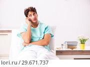 Купить «Young handsome man staying in hospital», фото № 29671737, снято 6 сентября 2018 г. (c) Elnur / Фотобанк Лори
