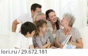 Купить «Grandmother looking at a photo with her family», видеоролик № 29672181, снято 20 октября 2009 г. (c) Wavebreak Media / Фотобанк Лори