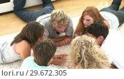 Купить «Adolescents in a Group talking to each other», видеоролик № 29672305, снято 22 октября 2009 г. (c) Wavebreak Media / Фотобанк Лори