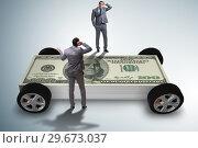 Купить «Businessman in the business concept with dollar car», фото № 29673037, снято 27 июня 2019 г. (c) Elnur / Фотобанк Лори