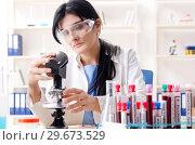 Купить «Female chemist working at the lab», фото № 29673529, снято 15 ноября 2018 г. (c) Elnur / Фотобанк Лори