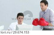 Купить «Furious manager wearing gloves talking to a woman», видеоролик № 29674153, снято 23 мая 2019 г. (c) Wavebreak Media / Фотобанк Лори