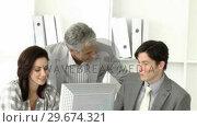 Купить «United business team working at a computer», видеоролик № 29674321, снято 24 марта 2019 г. (c) Wavebreak Media / Фотобанк Лори