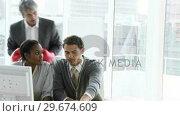 Купить «Competitive businessman supporting his team with boxing gloves», видеоролик № 29674609, снято 19 марта 2019 г. (c) Wavebreak Media / Фотобанк Лори