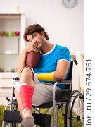 Купить «Injured man recovering from his injury», фото № 29674761, снято 21 сентября 2018 г. (c) Elnur / Фотобанк Лори