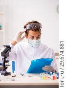 Купить «Male entomologist working in the lab on new species», фото № 29674881, снято 24 сентября 2018 г. (c) Elnur / Фотобанк Лори