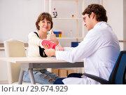 Купить «Young woman visiting doctor traumatologist», фото № 29674929, снято 24 сентября 2018 г. (c) Elnur / Фотобанк Лори