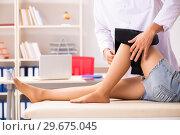 Купить «Young female patient visiting male doctor traumatologist», фото № 29675045, снято 24 августа 2018 г. (c) Elnur / Фотобанк Лори