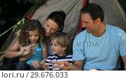 Купить «Family palying in front of a tent», видеоролик № 29676033, снято 7 ноября 2010 г. (c) Wavebreak Media / Фотобанк Лори