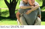 Elderly man carrying his aged wife. Стоковое видео, агентство Wavebreak Media / Фотобанк Лори