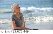 Aged woman waiting with a bike. Стоковое видео, агентство Wavebreak Media / Фотобанк Лори