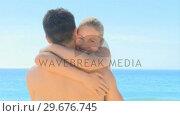 Купить «Attractive woman hugging boyfriend on a beach», видеоролик № 29676745, снято 15 ноября 2010 г. (c) Wavebreak Media / Фотобанк Лори