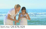 Mother and daughter taking a photo . Стоковое видео, агентство Wavebreak Media / Фотобанк Лори