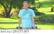 Купить «Middledaged man bodybuilding», видеоролик № 29677001, снято 16 ноября 2010 г. (c) Wavebreak Media / Фотобанк Лори