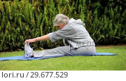 Купить «Mature woman doing stretching exercises on lawn», видеоролик № 29677529, снято 6 ноября 2010 г. (c) Wavebreak Media / Фотобанк Лори