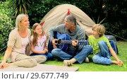 Купить «Family singing together», видеоролик № 29677749, снято 6 ноября 2010 г. (c) Wavebreak Media / Фотобанк Лори