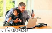 Купить «Businessman with his son having a lot of tasks», видеоролик № 29678029, снято 6 ноября 2010 г. (c) Wavebreak Media / Фотобанк Лори