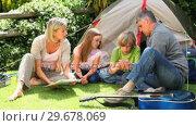 Купить «Family camping in a park», видеоролик № 29678069, снято 6 ноября 2010 г. (c) Wavebreak Media / Фотобанк Лори