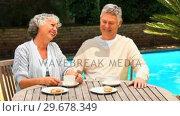 Retired couple having coffee outdoors. Стоковое видео, агентство Wavebreak Media / Фотобанк Лори