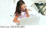 Купить «Young girl using her laptop», видеоролик № 29678481, снято 2 ноября 2011 г. (c) Wavebreak Media / Фотобанк Лори