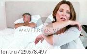 Купить «Upset wife sitting in her bed», видеоролик № 29678497, снято 2 ноября 2011 г. (c) Wavebreak Media / Фотобанк Лори