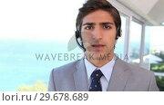 Купить «A businessman making an announcement», видеоролик № 29678689, снято 3 ноября 2011 г. (c) Wavebreak Media / Фотобанк Лори