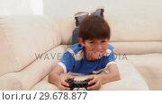 Купить «Boy loses at his video game», видеоролик № 29678877, снято 3 ноября 2011 г. (c) Wavebreak Media / Фотобанк Лори