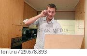 Купить «Man on the phone while using a laptop», видеоролик № 29678893, снято 3 ноября 2011 г. (c) Wavebreak Media / Фотобанк Лори