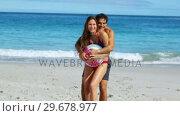 Купить «Smiling couple playing with a ball», видеоролик № 29678977, снято 15 ноября 2011 г. (c) Wavebreak Media / Фотобанк Лори