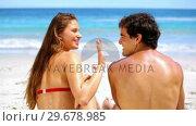 Купить «Happy woman applying sunscreen», видеоролик № 29678985, снято 15 ноября 2011 г. (c) Wavebreak Media / Фотобанк Лори