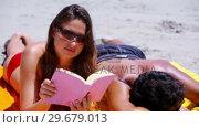 Купить «Relaxed brunette reading a book», видеоролик № 29679013, снято 15 ноября 2011 г. (c) Wavebreak Media / Фотобанк Лори