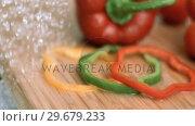 Купить «Water dripping on sliced peppers in super slow motion», видеоролик № 29679233, снято 26 января 2012 г. (c) Wavebreak Media / Фотобанк Лори