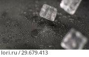 Купить «Ice cubes hitting ground in super slow motion», видеоролик № 29679413, снято 26 января 2012 г. (c) Wavebreak Media / Фотобанк Лори