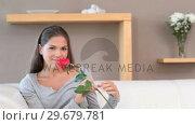 Купить «Brunette woman holding a rose», видеоролик № 29679781, снято 4 ноября 2011 г. (c) Wavebreak Media / Фотобанк Лори