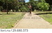 Купить «A woman jogs up a footpath towards and past the camera», видеоролик № 29680373, снято 17 ноября 2011 г. (c) Wavebreak Media / Фотобанк Лори