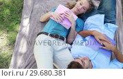 Купить «A couple sleep beside each other with books in the park», видеоролик № 29680381, снято 17 ноября 2011 г. (c) Wavebreak Media / Фотобанк Лори